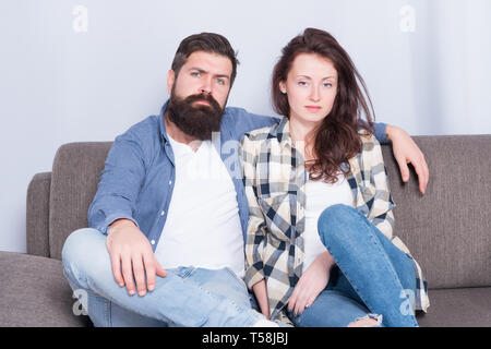 Regular couple relaxing on couch. Session at family psychotherapist. Couple in love hug looking at camera. Family relations. Family leisure. Happy and healthy relations. Bearded man and pretty girl. - Stock Photo