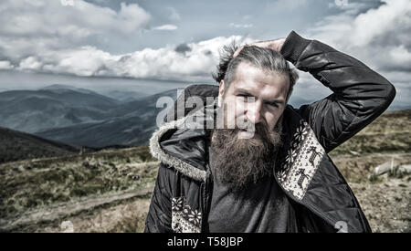 Wanderlust and hiking. Travel and adventure. Guy or bearded man at cold weather. Man with long beard and mustache outdoor. Hipster with bearded face at mountains. - Stock Photo