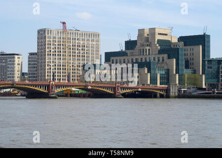 The MI6 Building stands on the south bank of the River Thames by Vauxhall Bridge, London - Stock Photo