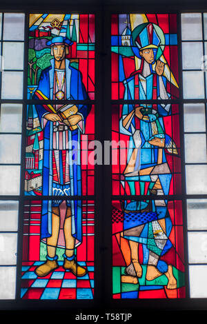 Carl Einar Andreas Forseth's colourful modern stained glass windows, of   protestant reformer Olaus Petri and Saint Sigfrid of Sweden, in Storkyrkan - Stock Photo