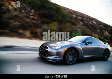 Nissan GTR on freeway going fast - Stock Photo