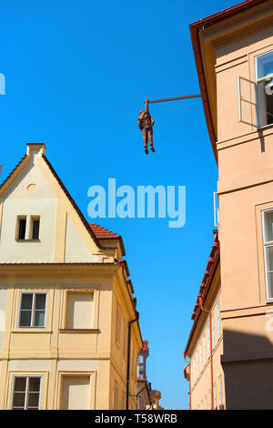 PRAGUE, CZECH REPUBLIC - July, 2018: Sculpture of the psychoanalyst Sigmund Freud hanging by a hand called Man Hanging Out created by the artist David - Stock Photo
