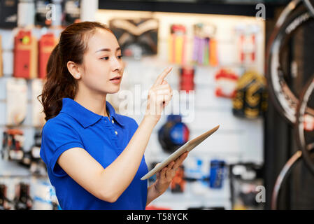 Woman working in the shop - Stock Photo