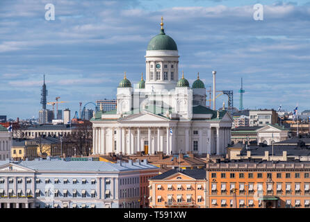 Helsinki, Finland - April 14 : Cathedral and other city buildings with central cityscape in Helsinki on April 14, 2019. With beautiful evening light. - Stock Photo