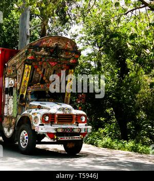 Decorated truck at the road - 07 may 2015 Karakoram highway, Pakistan - Stock Photo