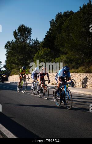 Woman's Cycle race through the La Safor mountains near Gandia Spain - Stock Photo