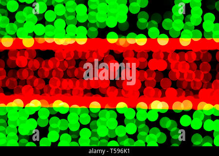 Unfocused abstract green and red bokeh on black background. defocused and blurred many round light. - Stock Photo