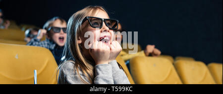 panoramic shot of exited multicultural friends in 3d glasses watching movie together - Stock Photo