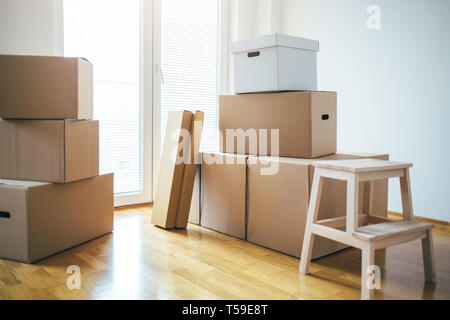 Moving boxes in new apartment. Moving into a new apartment - Stock Photo