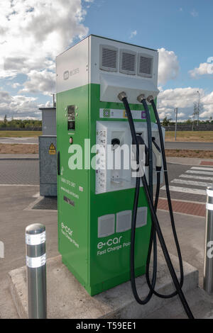 An e-car Fast Charge Point, Manor Stone Service Station on the M8 Motorway, Tintore, Co. Laois, Ireland. - Stock Photo