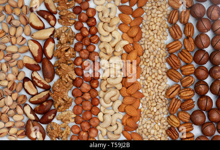 background from a mixture of nuts on a light background. view from above - Stock Photo