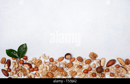 mix of nuts on a light background. view from above. banner. copy space - Stock Photo