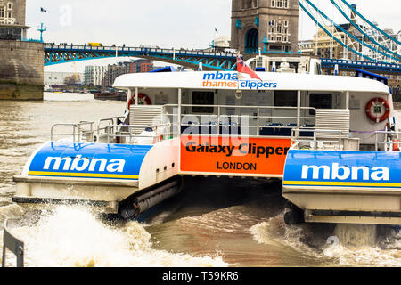 London, Great Britain. April 12, 2019 River Bus. A view of an MBNA Thames Clipper river bus on the Thames. - Stock Photo