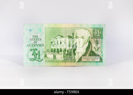 A 1 (one) pound bank note from Guernsey isolated over white. - Stock Photo
