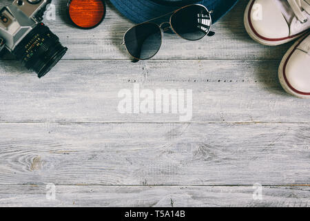 Accessories of traveler on wooden table in flat lay design. Travel concept. - Stock Photo