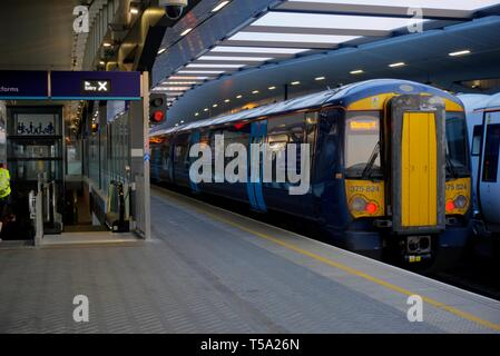 London, United Kingdom - April 15, 2019: Southeastern train in blue livery at platform at London Bridge station - Stock Photo
