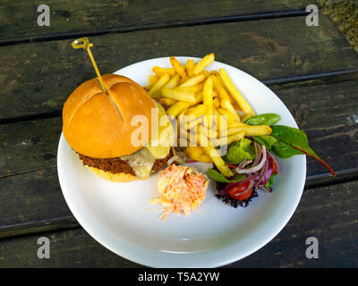 Lord Stones Café  lunch  a Sloppy Joe prime Belted Galloway  beef burger  with melted cheddar cheese served with coleslaw chips and salad - Stock Photo