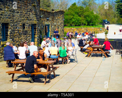 Family groups enjoying spring sunshine at the popular Lord Stones café in the Cleveland Hills North Yorkshire Moors National Park - Stock Photo