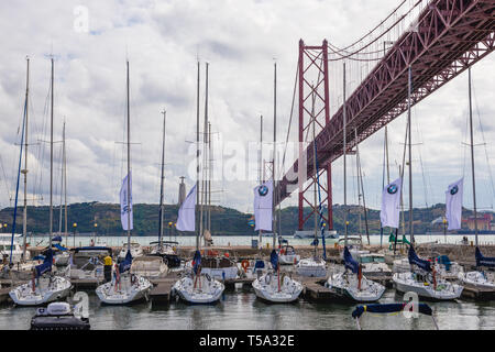 Santo Amaro Recreation dock next to 25 de Abril Bridge in Lisbon, Portugal conecting the city to Almada on the left side of Tagus river - Stock Photo