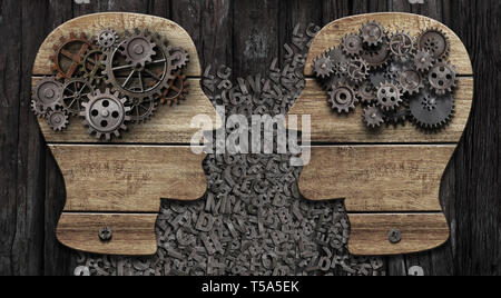 Two wooden heads with gears commucating - Stock Photo