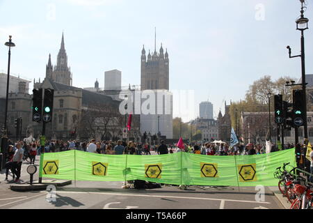 Extinction rebellion protestors setup a road block and banners - Stock Photo
