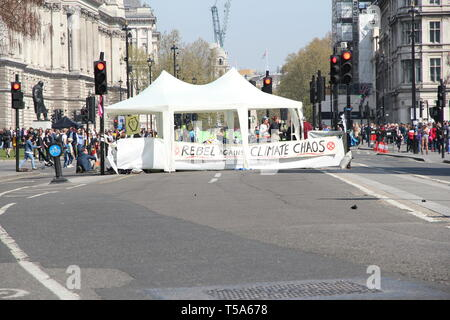 Parliament Square, London, England. Extinction rebellion protestors setup a road block and banners - Stock Photo