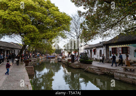 Mar 2017 -Tongli, Jiangsu, China: Tourists walk in the evening along the canals of Tongli, one of the famous water villages not far from Hangzhou and  - Stock Photo