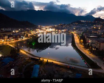 View from the top in Sapa city at sunset. Sapa is a famous scenery city in Lao Cai Province in northwest Vietnam. Lake in the center of Sapa. - Stock Photo