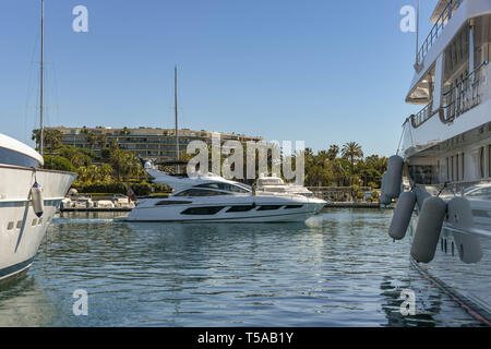CANNES, FRANCE - APRIL 2019: Luxury motor cruiser in the Port Pierre Canto marina in Cannes. - Stock Photo