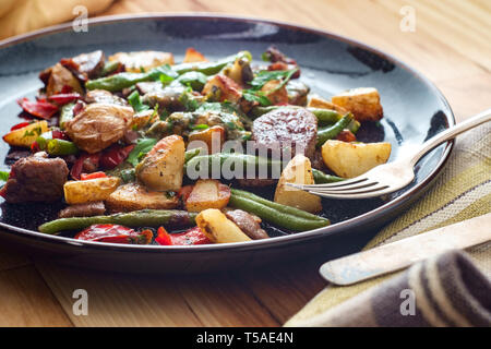 Chimichurri verde grilled steak and potatoes with red bell pepper and green beans - Stock Photo