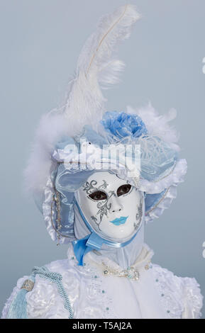 Venice carnival portrait, Italy, person wearing white mask and feather hat - Stock Photo