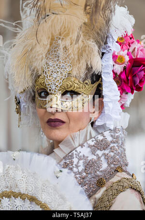 Middle aged woman wearing traditional Venetian mask, Venice carnival portrait, Italy - Stock Photo