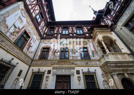 View from courtyard of Peles Palace, former royal castle, built between 1873 and 1914, located near Sinaia city in Romania - Stock Photo