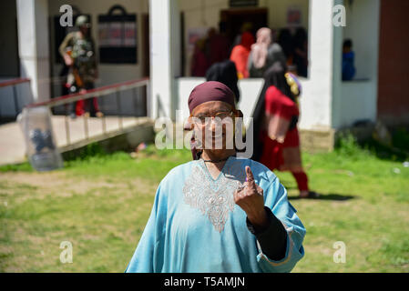 A Kashmiri voter seen showing off his inked finger after casting her vote at a polling station in Anantnag, South Kashmir. On the third phase of India's Parliamentary elections, Indians went to polls amid complete shut down and internet gag. - Stock Photo