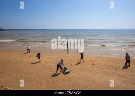 Picture dated April 21st shows people out on the beach playing cricket in Walton-on-the-Naze,Essex,on Easter Sunday afternoon and making the most on the hot weather.