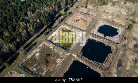 Sewage farm. Static aerial photo looking down onto the clarifying tanks and green grass. - Stock Photo
