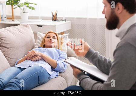 Professional psychologist is conducting consultation to stressful patient - Stock Photo