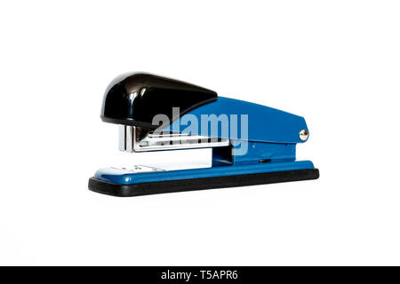 Close-up of a blue and black metal manual stapler isolated on a white background - Stock Photo