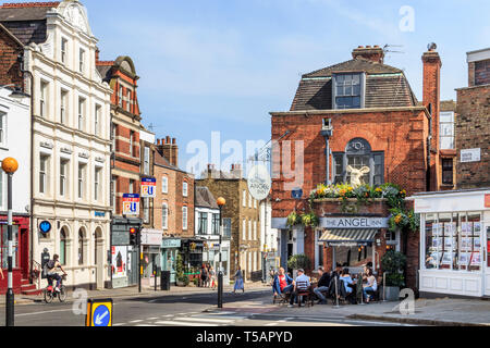 Customers drinking outside the historic Angel Inn in Highgate Village, London, UK, on a warm and sunny Easter weekend - Stock Photo