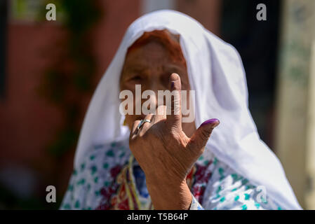 Anantnag, Jammu and Kashmir, India. 23rd Apr, 2019. A Kashmiri voter seen showing her inked finger after casting her vote at a polling station in Anantnag, South Kashmir.On the third phase of India's Parliamentary elections, Indians went to polls amid complete shut down and internet gag. Credit: Idrees Abbas/SOPA Images/ZUMA Wire/Alamy Live News - Stock Photo