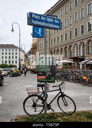 Munich, Bavaria, Germany. 23rd Apr, 2019. The militant neonazi group III. Weg left numerous posters at the Plaza for the Victims of National Socialism in Munich, Germany this Tuesday. In an act being seen as a direct provocation, it appears a poster board from the party die Linke (The Left) was pulled off the pole and left on the ground to make way for the III. Weg poster. Despite Munich having a charged history as the former ''Capital of the Movement'' passers by simply ignored the symbolism of this provocation. Credit: ZUMA Press, Inc./Alamy Live News - Stock Photo