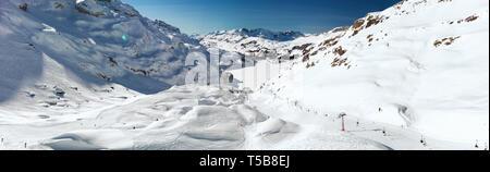 Beautiful winter landscape with Swiss Alps. Skiers skiing in famous Engelgerg - Titlis ski resort, Switzerland, Europe. - Stock Photo