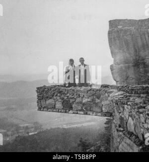A newly married couple travels to iconic Rock City for their honeymoon in 1948. - Stock Photo