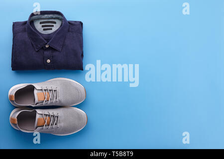 Mens summer casual clothing outfits and accessories flat lay on blue background, top view - Stock Photo