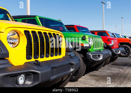 Noblesville - Circa April 2019: Jeep Wranglers on display at a Chrysler Jeep dealership. The subsidiaries of FCA are Chrysler, Dodge, Jeep, and Ram II - Stock Photo