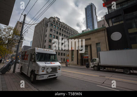 TORONTO, CANADA - NOVEMBER 13, 2018: Fedex logo on one of their delivery trucks in a street of Toronto, Ontario. Fedex is an American courier speciali - Stock Photo