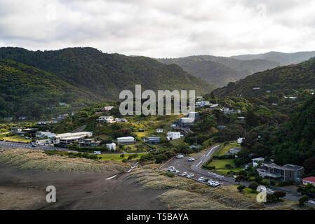 West Auckland, New Zealand. Piha village moments after sunrise - Stock Photo