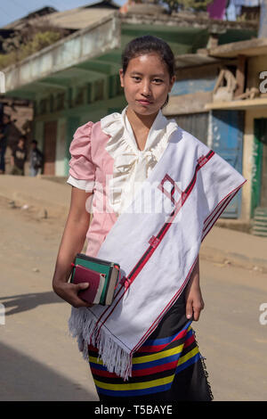 Mon, Nagaland. Young lady dressed to attend church service - Stock Photo