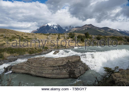 The Paine Waterfall with the Cuernos del Paine in the background, Torres del Paine National Park, Southern Patagonia, Chile - Stock Photo