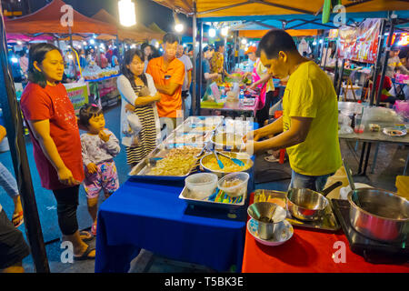 Night Market, next to railway station, Sathani street, Trang, Thailand - Stock Photo